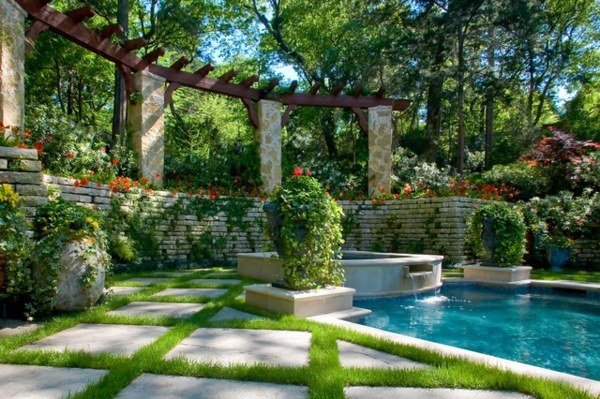 Vertical garden next to the swimming pool brings more for Garden designs around pools