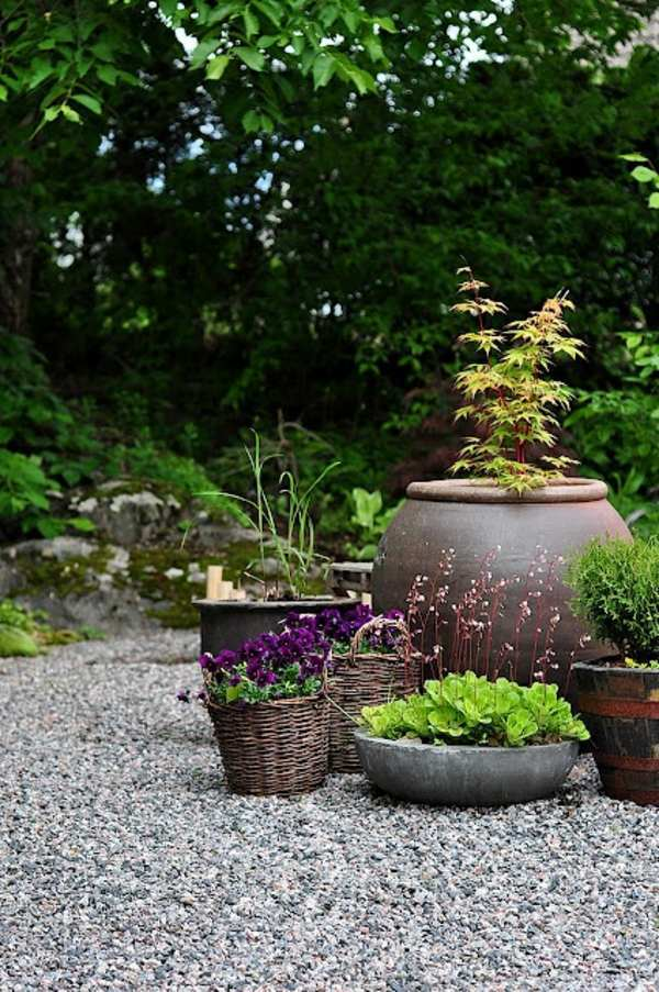 rattan baskets and clay pots landscaping with gravel and stones 25 garden ideas for you