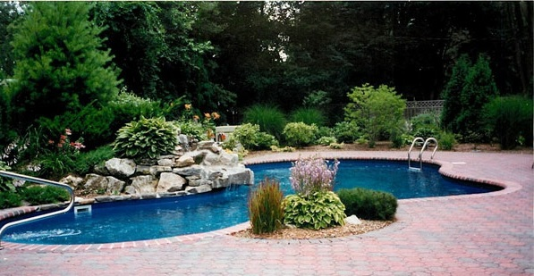 Swimming pool in the garden landscape ideas for swimming for Landscaping ideas for pool areas