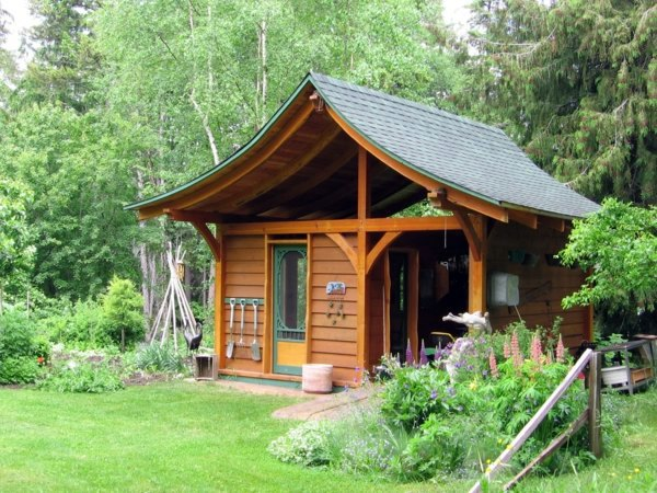 Garden houses made of wood nice and compact garden shed in the backyard interior design - Summer house plans delight relaxation ...