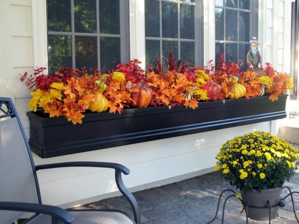 Insert autumn flowers as table decoration or home great for Fall balcony decorating ideas