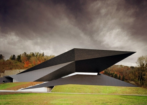 15 spectacular building designs where origami meets for Festival hall in erl