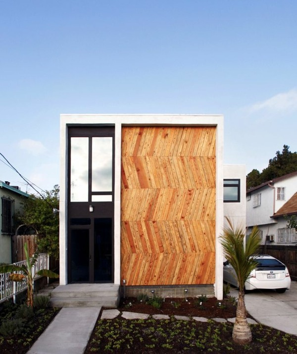 Modern facade cladding for an impressive house character for Jc house architecture modern facade