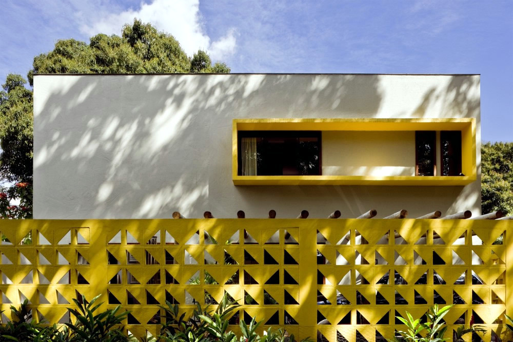 Flat Roof Concrete House With Highlights In Bright Yellow