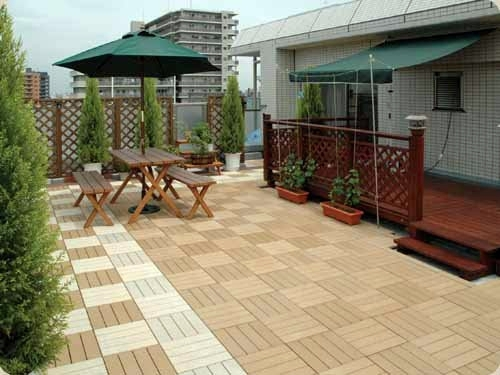 Lay patio and balcony with wooden tiles use wood tiles for Terrace tiles