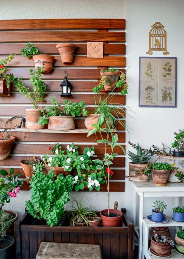 Create a vertical garden for your home by wooden panels for Home vertical garden