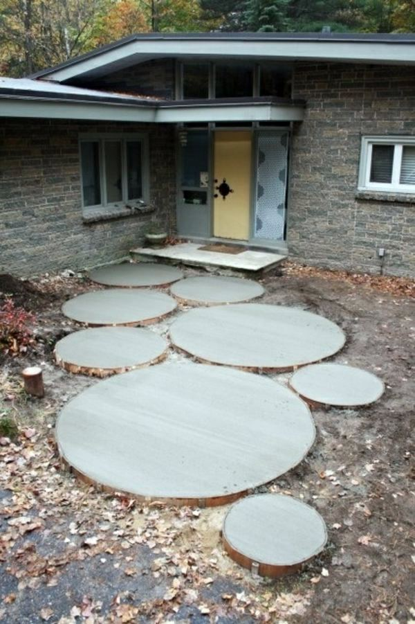 How can one create his front garden design modern Round wooden stepping stones