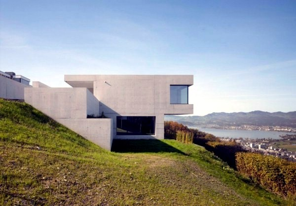 Modern house with minimalist design on a slope villa k for Contemporary floor plans sloped property