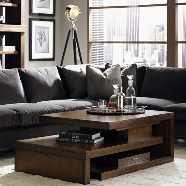 A wooden coffee table in the living room adds warmth and ...