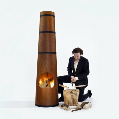 Heating for exterior mounted Outdoor wood-burning stove in the form of  chimney of Frederik Roijé - Outdoor Wood-burning Stove In The Form Of Chimney Of Frederik