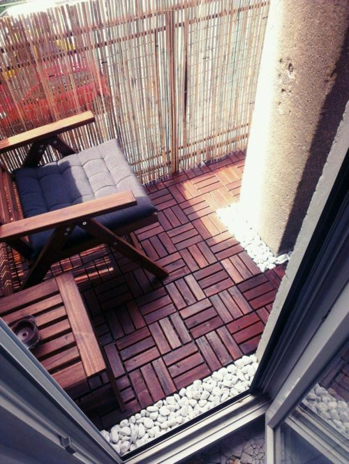 Wood tiling - wooden floor on the balcony