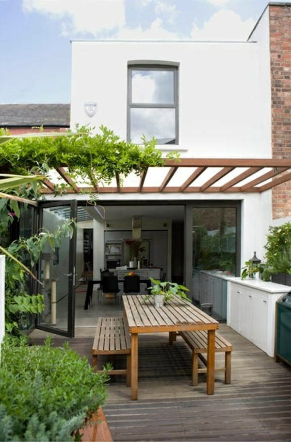 dining table surrounded by garden benches covered terrace 50 ideas for patio roof of modern houses design - Home Terrace Design
