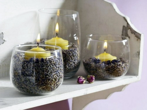 Beautiful glass container and yellow candles inside 37 Cool Candles Ideas  for Summer - original centerpiece on the table