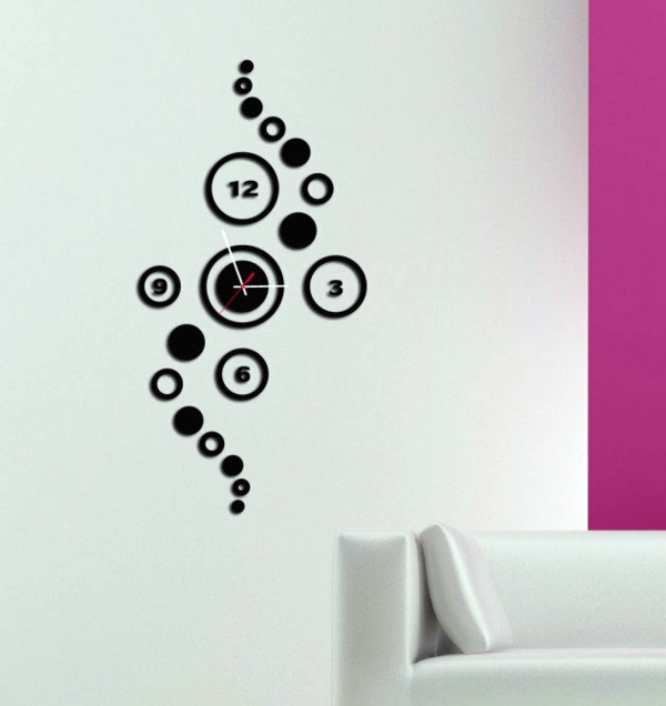 Cute Shapes In Black Designer Wall Clocks That Serve As Decoration
