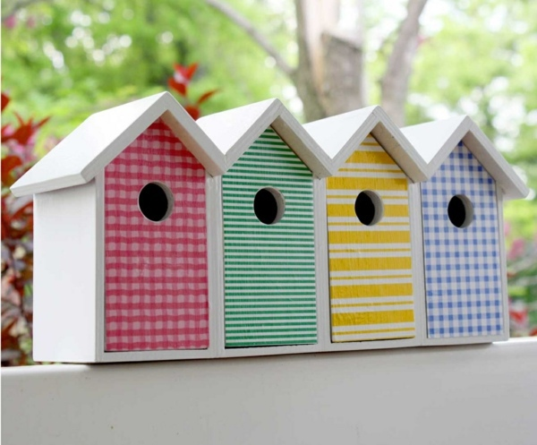 Each bird wants to enter the house Brightly painted birdhouses Great ...