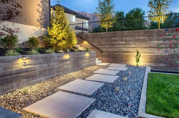 Install pebbles and river stones beautiful landscape in for Installing river rock landscaping