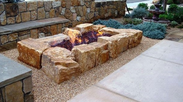 Install pebbles and river stones - beautiful landscape in the garden