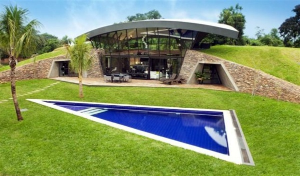 Modern underground hillside houses in luque paraguay for Modern house design on hillside