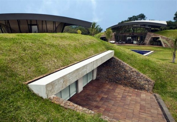 Modern underground hillside houses in luque paraguay for Classic underground house