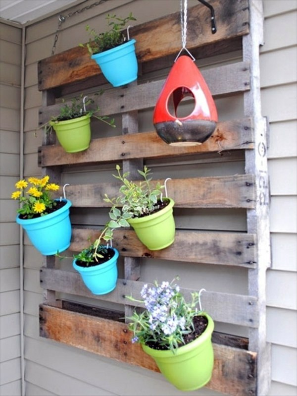 Create a vertical garden for your home by wooden panels