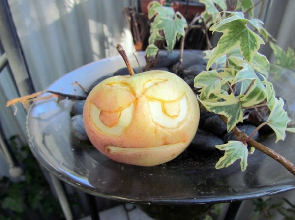 Decorative fruit carving - apple art and expressive faces