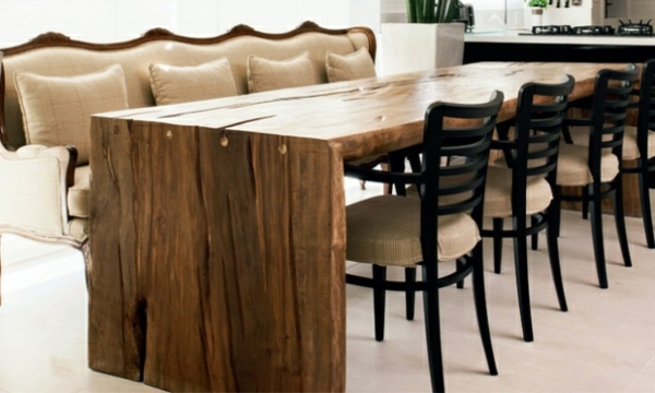 A wooden coffee table in the living room adds warmth and naturalness in